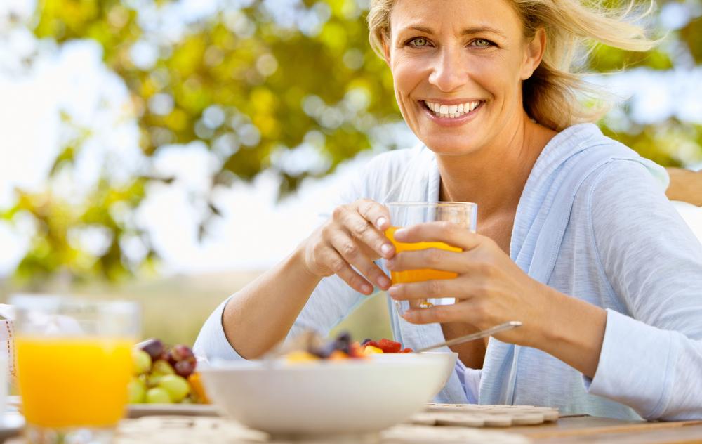 Happy Woman Eating Breakfast